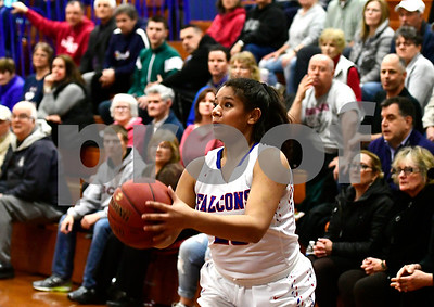 2/28/2017 Mike Orazzi | Staff St. Paul's ChantellMarie Lopez (23) during Tuesday night's Class M First Round State Girls Basketball Tournament with Griswold in Bristol.