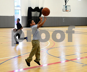 2/28/2017 Mike Orazzi | Staff Jordan Delgado and Jose Roche while shooting hoops at the Bristol Boys and Girls Club Tuesday.