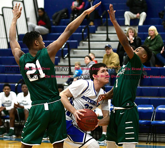 2/4/2017 Mike Orazzi | Staff Southington's Jeremy Mercier (33) and Northwest Catholic's Cairo McCrory  (21) and Primo Spears (1) Saturday night.