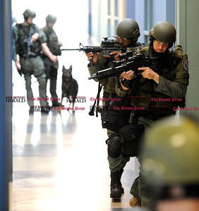 5/26/2011 Mike Orazzi | Staff Members of the North Central Emergency Services SWAT team atTunxis Community College during a drill on Thursday morning. Area police departments, students and faculty participated in a simulated hostage situation for most of the morning.