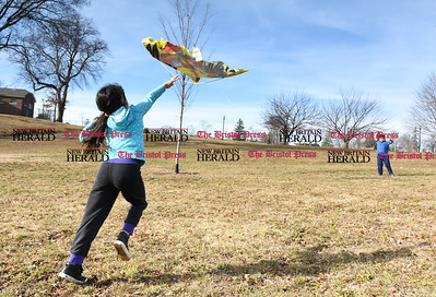 020817  Wesley Bunnell | Staff  Seven year old Amal Ayyash, left, helps her brother Ayoub Ayyash , age 9, to get his kite off the ground on a mild and windy afternoon at Walnut Hill Park on Wednesday February 8th.