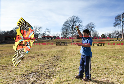 020817  Wesley Bunnell | Staff  Ayoub Ayyash , age 9, prepares to fly his kite on a mild and windy afternoon at Walnut Hill Park on Wednesday February 8th.