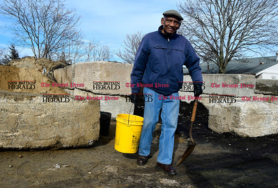 2/8/2017 Mike Orazzi | Staff Charles Byrd fills a bucket with sand from the city's resident pile on Vincent P. Kelly Road while preparing for an overnight snowfall Wednesday.