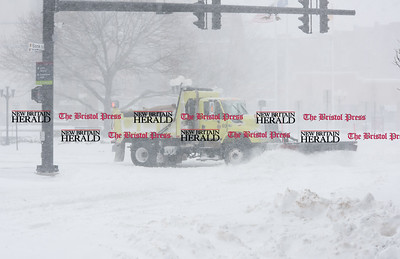 020917  Wesley Bunnell | Staff  A city snow plow clears the intersection at West Main & Main St with Central Park in the background during a heavy snowstorm on Thursday Feb 9.