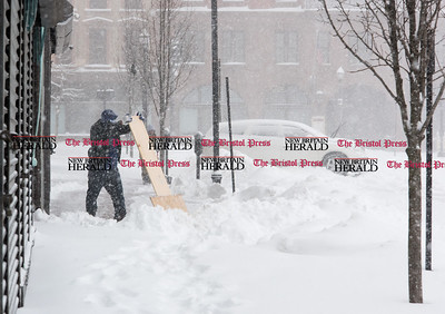 020917  Wesley Bunnell | Staff  Snow is cleared off of a sidewalk using a home made shovel on Main St during the heavy snowstorm on Thursday Feb 9.