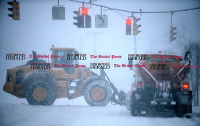 2/9/2017 Mike Orazzi | Staff A couple on City of Bristol snow plows at the intersection of Route 6 and North Main Street Thursday morning.