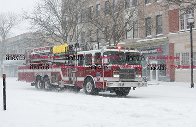 020917  Wesley Bunnell | Staff  Ladder Truck 2 of the New Britain Fire Department makes its way down Main St. in downtown New Britain during a heavy snowstorm on Thursday Feb 9.