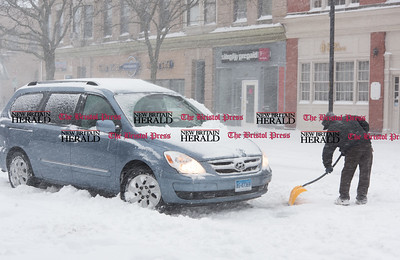 020917  Wesley Bunnell | Staff  Gerardo Colon of New Britain took time from shopping at C-Town in downtown New Britain to help out a fellow patron who was unable to pull away from the curb during a heavy snowstorm on Thursday Feb 9.