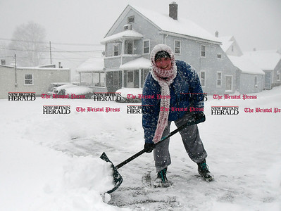 2/9/2017 Mike Orazzi | Staff Michelle Sauer shovels her driveway off Route 6 in Terryville Thursday morning.