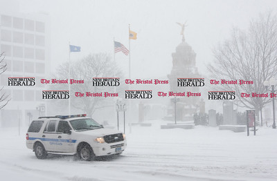 020917  Wesley Bunnell | Staff  A New Britain Public Service Officer vehicle drives past Central Park in downtown New Britain during a heavy snowstorm on Thursday Feb 9.