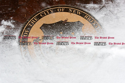 020917  Wesley Bunnell | Staff  The New Britain City seal is partially obscured during the winter storm on Thursday Feb 9.