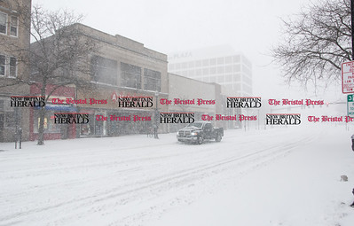 020917  Wesley Bunnell | Staff  The view down Main St. in downtown New Britain as a truck drives past Amato's Toys during a heavy snowstorm on Thursday Feb 9.