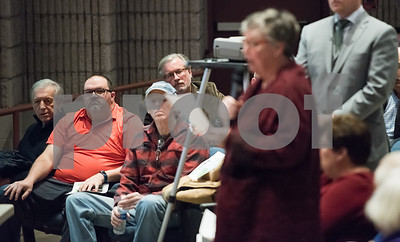 02/05/18  Wesley Bunnell | Staff   A public hearing was held Monday evening at Plainville Middle School regarding the Farmington Canal Heritage Trail Gap Closure Trail Study. Representative William Petit Jr sits in the background as a audience member addresses her concerns about the proposed alignment.