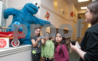 02/05/18  Wesley Bunnell | Staff   Shillelagh Gallagher, age 11, and her sister Calliope Gallagher, age 8, read from a clue during a scavenger hunt at the Bristol Public Library on Monday evening as Librarian Mrs. Alex stands off to the right.  The scavenger hunt is part of Mrs. Alex's Nancy Drew class.