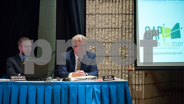 02/05/18 Wesley Bunnell | Staff A public hearing was held Monday evening at Plainville Middle School regarding the Farmington Canal Heritage Trail Gap Closure Trail Study. Town Manager R.E. Lee sits on stage during the meeting.