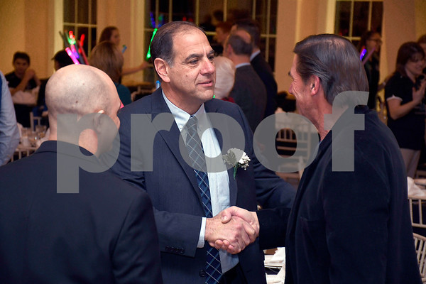 2/6/2018 Mike Orazzi | Staff YMCA Person of the Year Mike DeFeo (center) during the Southington YMCA's 89th Annual Meeting &quote;May the Y Be With You&quote; held at the Aqua Turf Club in Southington Tuesday night.