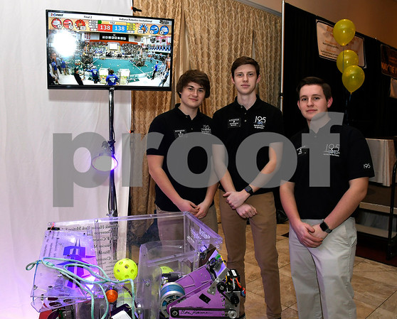 2/6/2018 Mike Orazzi | Staff Southington Cyberknights robotics team members Andrew Bauer, Christopher Bonomi and Jake Hayes during the Southington YMCA's 89th Annual Meeting &quote;May the Y Be With You&quote; held at the Aqua Turf Club in Southington Tuesday night.
