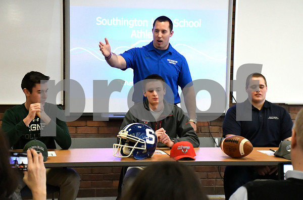 2/9/2018 Mike Orazzi | Staff Southington High School Football Coach Southington talks about Tim O'Shea, Sam Thomson and James Starr sign their letters of intent to play football at the next level during a ceremony at Southington High School Friday afternoon.