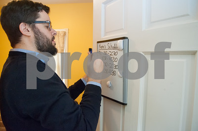 02/06/18  Wesley Bunnell | Staff  Case Manager Nate Fox writes his schedule on his office door at the Family Promise Day Center in New Britain. Family Promise provides a place for homeless families to eat meals together, shower and prepare for school and work.