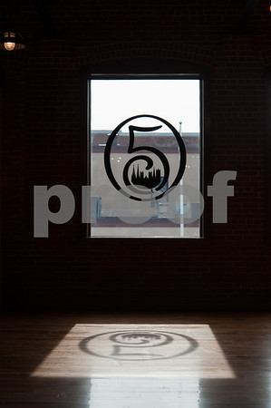 02/09/18 Wesley Bunnell | Staff Work continues on Friday afternoon at Five Churches Brewing at 193 Arch St in New Britain in anticipation of its grand opening that is yet to be determined. A silhouette of the company logo can be seen reflected on the newly finished floor.