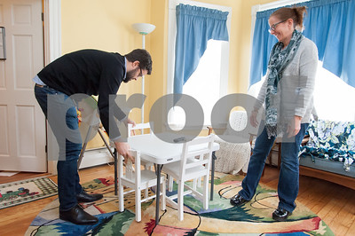 02/06/18  Wesley Bunnell | Staff  Case Manager Nate Fox helps Interim Director Peg Kelly straighten up one of the family rooms at the Family Promise Day Center in New Britain. Family Promise provides a place for homeless families to eat meals together, shower and prepare for school and work.