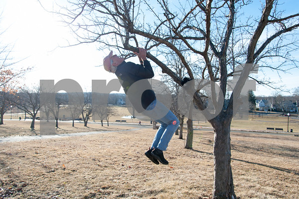 02/12/18 Wesley Bunnell | Staff Pete Webster varies his workout in Walnut Hill Park on Monday afternoon by using a tree for pull ups.