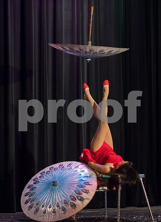 02/12/18 Wesley Bunnell | Staff CCSU presented a 2018 Chinese New Year Celebration at Torpe Theatre, Davidson Hall on Monday night to bring in the Year of The Dog. Guinness Record Holder for most open umbrellas balanced simultaneously, Lina Liu, demonstrated classical umbrella acrobatics.