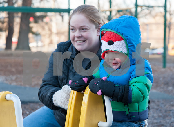 02/12/18 Wesley Bunnell | Staff Megan Lockshire and one year old son Cole smile as Cole sits on a teeter tot opposite from his sister Charlie, age 3 in Page Park on Monday afternoon.