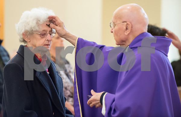 02/14/18 Wesley Bunnell | Staff Parishioners of St. Ann Church in Bristol attended afternoon mass on Ash Wednesday. Former Bristol Town Clerkk Rita Brown receives ashes from Father Robert Russo.