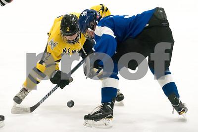 02/14/18  Wesley Bunnell | Staff  Hall-Southington hockey vs Newington-Berlin on Wednesday night at Newington Arena. Newington's Sam Hedlund (12) vs Southington's Graham Kennedy (3).