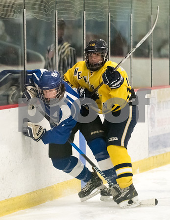 02/14/18 Wesley Bunnell   Staff Hall-Southington hockey vs Newington-Berlin on Wednesday night at Newington Arena. Newington's Nick Deriu (18) against the boards with a Southington skater.