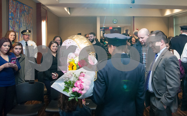 02/15/18 Wesley Bunnell | Staff The New Britain Police Department promoted three of its own including the first female captain in its history. Newly promoted Captain Jeanette Portalatin is greeted by family and friends after her promotion.