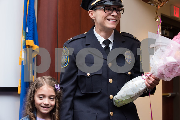 02/15/18 Wesley Bunnell | Staff The New Britain Police Department promoted three of its own including the first female Captain in its history. Captain Jeanette Portalatin stands with her daughter Mika after the ceremony.