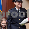 02/15/18  Wesley Bunnell | Staff<br /> <br /> The New Britain Police Department promoted three of its own including the first female Captain in its history. Captain Jeanette Portalatin stands with her daughter Mika after the ceremony.