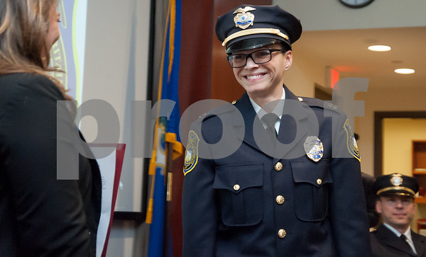 02/15/18 Wesley Bunnell | Staff The New Britain Police Department promoted three of its own including the first female captain in its history. Jeanette Portalatin smiles just after being sworn in as captain by Mayor Erin Stewart.