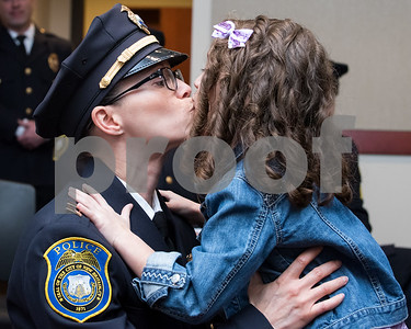 02/15/18  Wesley Bunnell | Staff  The New Britain Police Department promoted three of its own including the first female Captain in its history. Captain Jeanette Portalatin kisses her six year old daughter Mika just after Mika helped pin her mothers badge on her uniform.