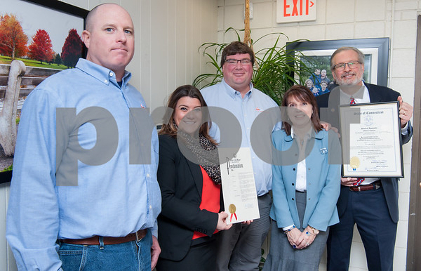 02/20/18 Wesley Bunnell | Staff Collier Electric Corp celebrated 25 years in business with presentations on Tuesday morning by Mayor Erin Stewart and Representative William Petit Jr. Vice Presdient and Secretary Bryson Burse, Mayor Erin Stewart, President Scott Pehmoeller, Administrative Assistant and Safety Officer Stacey Rich and Representative William Petit Jr.