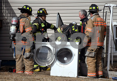 2/20/2018 Mike Orazzi | Staff Bristol firefighters extinguish a washer fire at a home on Rockwell Avenue in Bristol Tuesday.