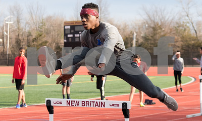 02/26/18  Wesley Bunnell | Staff  NBHS Junior Chaz Williams runs the hurdles as the rest of his indoor track team spent Monday afternoon holding outdoor practice at Veterans' Stadium taking advantage of the mild weather.