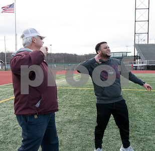 02/26/18  Wesley Bunnell | Staff  NBHS Indoor Track Coach Tim Kolodziej coaches Senior Giovanni Cirinna in shot put technique as the rest of his team spent Monday afternoon holding outdoor practice at Veterans' Stadium taking advantage of the mild weather.