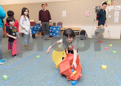 02/26/18  Wesley Bunnell | Staff  Jackie, age 6, picks up the dots as the title character Pac-Man in the 1980's video game in a life size version at the Bristol Public Library on Monday night. Waiting as ghosts are Kevin, age 4, and Kayla, age 8.  The video game was organized by Childrens and Teen Librarian Mr. Jose , rear L, and volunteer Richard Tian, right.