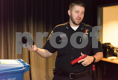 02/27/18  Wesley Bunnell   Staff  Ofc. Joe Blansfield from the New Britain Police Department Training Division holds a holster and training pistol which is designed for special use with the department's indoor MILO Range to help train officers in using firearms in various simulated scenarios.