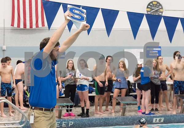 02/21/18 Wesley Bunnell | Staff Southington boys swimming defeated North West Catholic Wednesday afternoon at the Southington YMCA 90-71. Head Coach Evan Tuttle motions to his swimmers near the end of the meet.