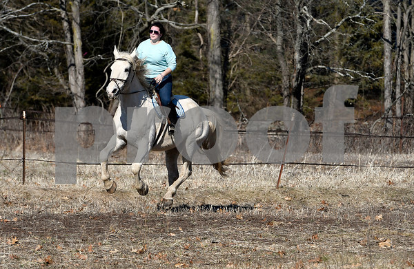 2/21/2018 Mike Orazzi | Staff Angela DeGennaro while riding Dublin,15, at Moonracer Farms on Shrub Road in Bristol on an unusually warm day in February Wednesday.