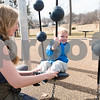 02/21/18  Wesley Bunnell | Staff<br /> <br /> Teacher Melissa Bengston helps Rowen, age 2, as he sits on the wobblers at the Walnut Hill Park on a warm Wednesday morning. The two are from the New Britain YMCA Childcare Academy at 111 Hart St.