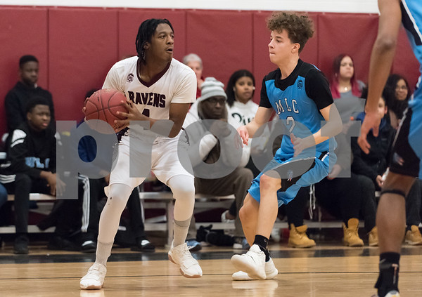 02/02/18 Wesley Bunnell   Staff Innovation boys basketball vs MLC on Friday evening at Innovation High School. Andre Sterling (4).