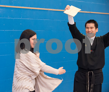 02/22/18  Wesley Bunnell | Staff  Master Hyung Yang from Yang's U.S. Taekwondo Academy in Newington gave demonstrations on Thursday 2/22 at Lincoln School which involved teachers and elementary students. Teacher Michelle Borselle holds her wood breaking pose after breaking a piece of board held by Master Yang.