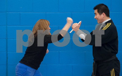 02/22/18  Wesley Bunnell | Staff  Master Hyung Yang from Yang's U.S. Taekwondo Academy in Newington gave demonstrations on Thursday 2/22 at Lincoln School which involved teachers and elementary students. Teacher Amy Greaves prepares to break a wood held by Master Yang.