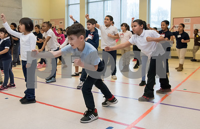 02/22/18  Wesley Bunnell | Staff  Master Hyung Yang from Yang's U.S. Taekwondo Academy in Newington gave demonstrations on Thursday 2/22 at Lincoln School which involved teachers and elementary students. Students including Javier Collazo, middle, practice a technique shown by Master Yang.