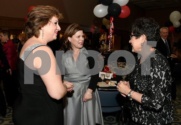 2/24/2018 Mike Orazzi | Staff Yvonne Muniz and Nancy Rodriguez talk with Dr. Zulma Toro, president of Central Connecticut State University, during the Women of Influence Gala held at CCSU Saturday evening in New Britain.